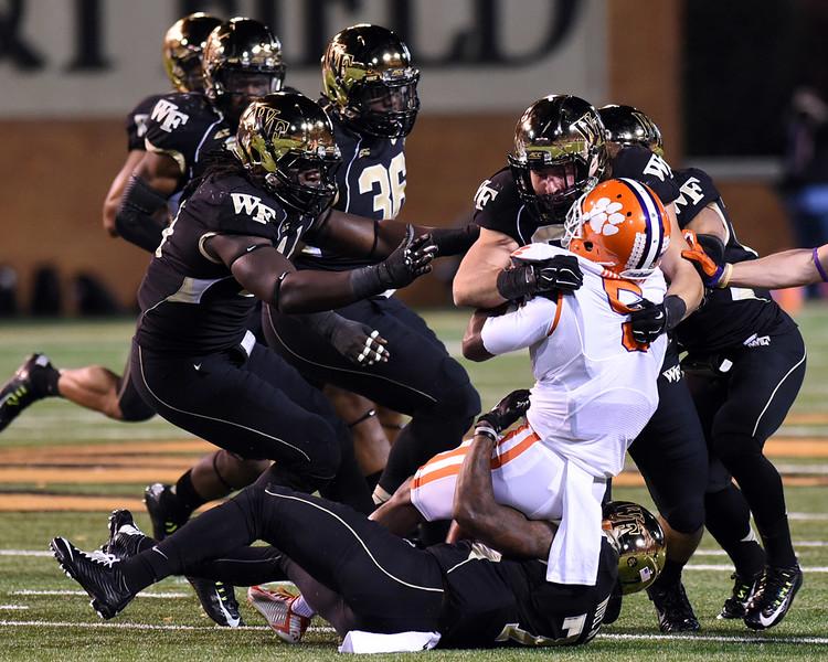 Merrill Noel & Hunter Williams tackle G Hopper.jpg