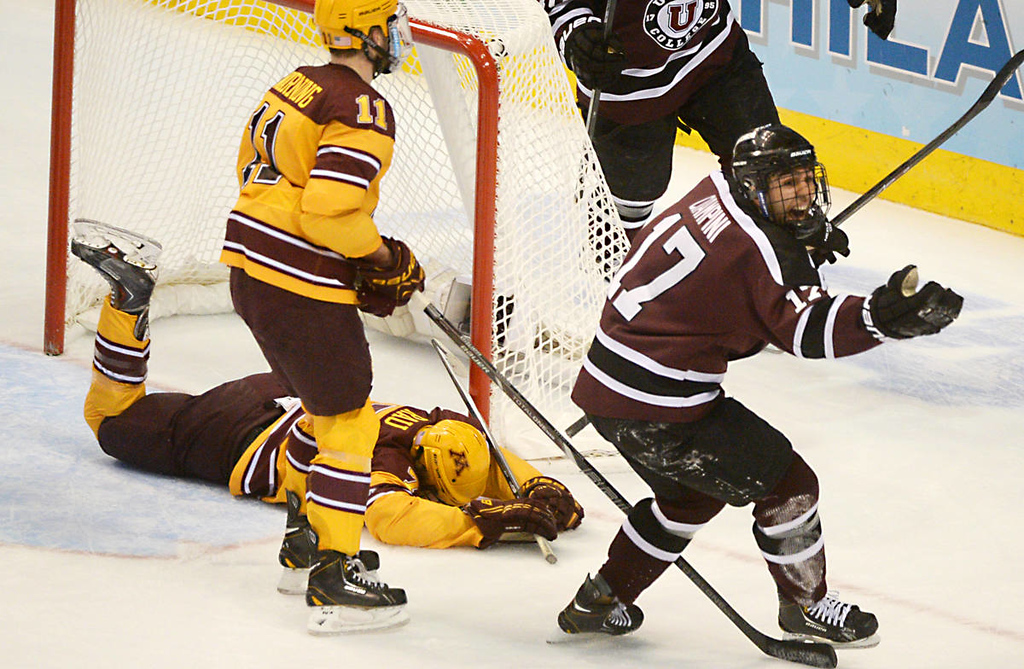 . Union College junior forward Daniel Ciampini celebrates his goal as Minnesota junior forward Kyle Rau lays on the ice after not being able to stop the shot in the first period of the NCAA Frozen Four Championship Game at the Wells Fargo Center in Philadelphia, Saturday, April 12, 2014.  (Pioneer Press: John Autey)