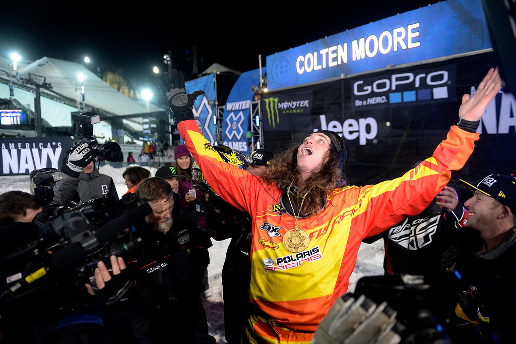 . Colten Moore looks into the sky after capturing the gold medal in the snowmobile freestyle final. Moore\'s older brother, Caleb, died last year as a result of injuries suffered ini the same event. X Games Aspen at Buttermilk on Thursday, January 23, 2014. (Photo by AAron Ontiveroz/The Denver Post)