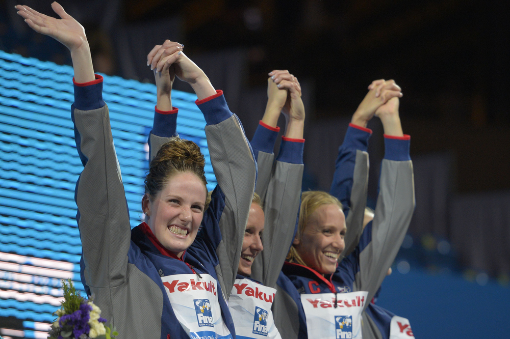 . (From L) Gold medalists US swimmers Missy Franklin, Jessica Hardy, Dana Vollmer celebrate on the podium during the award ceremony of the women\'s 4x100-metre medley relay swimming event in the FINA World Championships at Palau Sant Jordi in Barcelona on August 4, 2013.  FABRICE COFFRINI/AFP/Getty Images