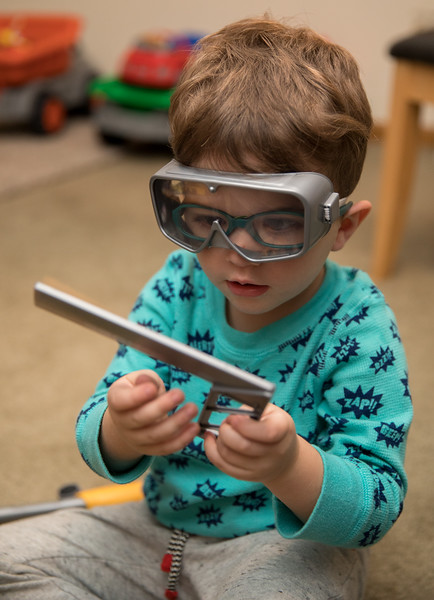 Caleb with Goggles on playing with Square.jpg