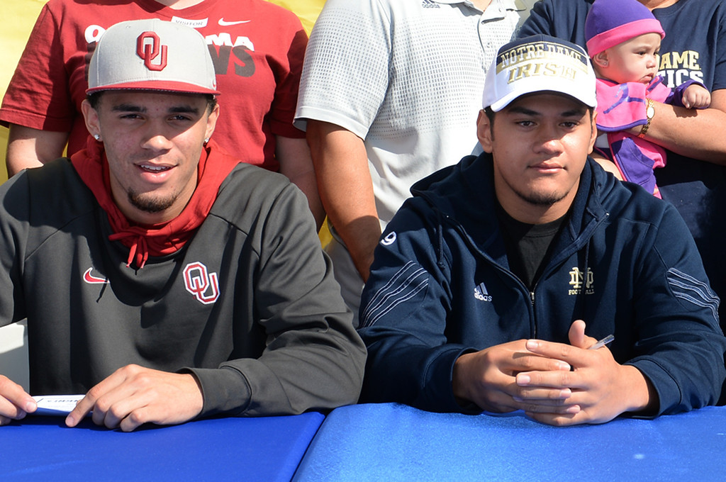 . Football players, from left, Dallis Todd, Oklahoma, and Tyler Luatua, Notre Dame, during National Signing Day at La Mirada High School on Wednesday February 5, 2014. (Staff Photo by Keith Durflinger/Whittier Daily News)