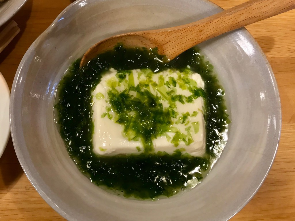 Tofu with fresh seaweed.