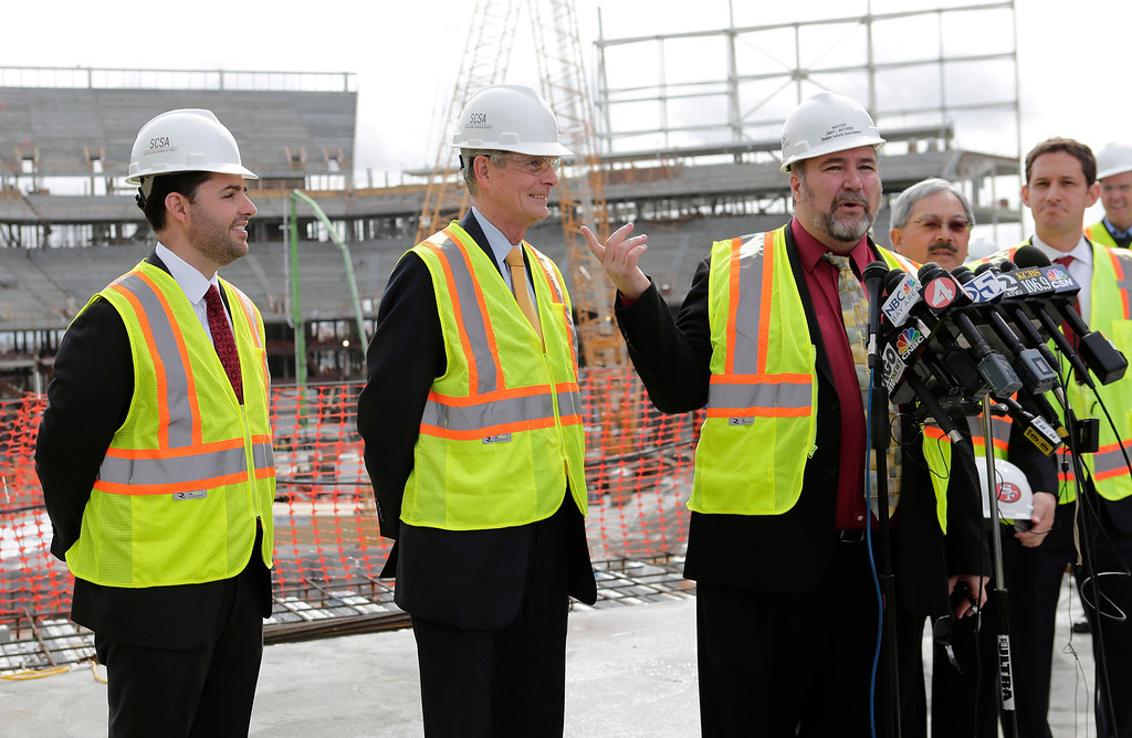 . Left to right: Jed York, 49ers CEO, and Chuck Reed, San Jose mayor, listen to Jamie Matthews, Santa Clara mayor, during a press conference at the construction site of the new 49ers stadium in Santa Clara, Calif. on Wednesday, March 6, 2013. The Super Bowl Host Committee gave a sneak peak of the stadium. They also remind the public that they are competing against Miami for the bragging rights of hosting the 50th Super Bowl in 2016.  (Gary Reyes/ Staff)
