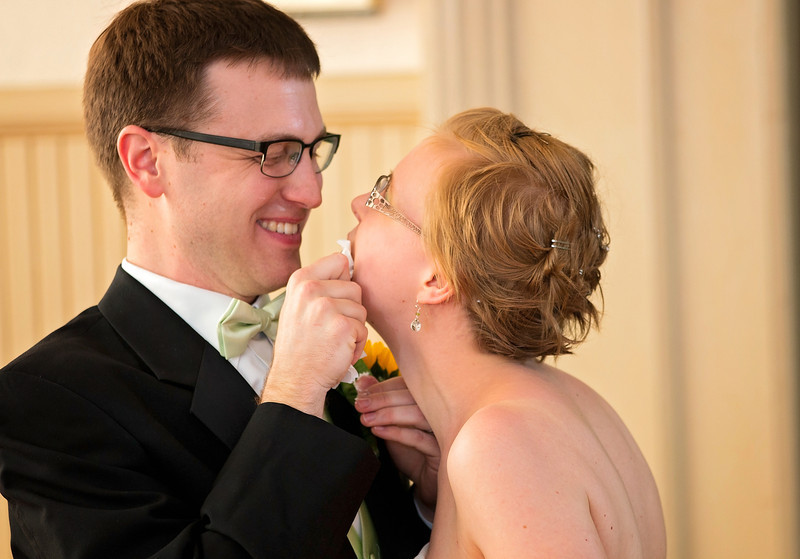 Groom cleaning up brides face.jpg