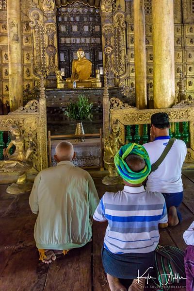 Praying inside Shwenandaw Kyaung Monastery.