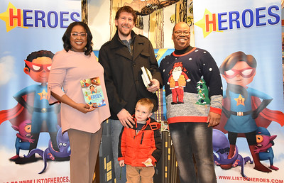 "Mayor reads ""Heroes""  book by Van White. 12/20/2017"