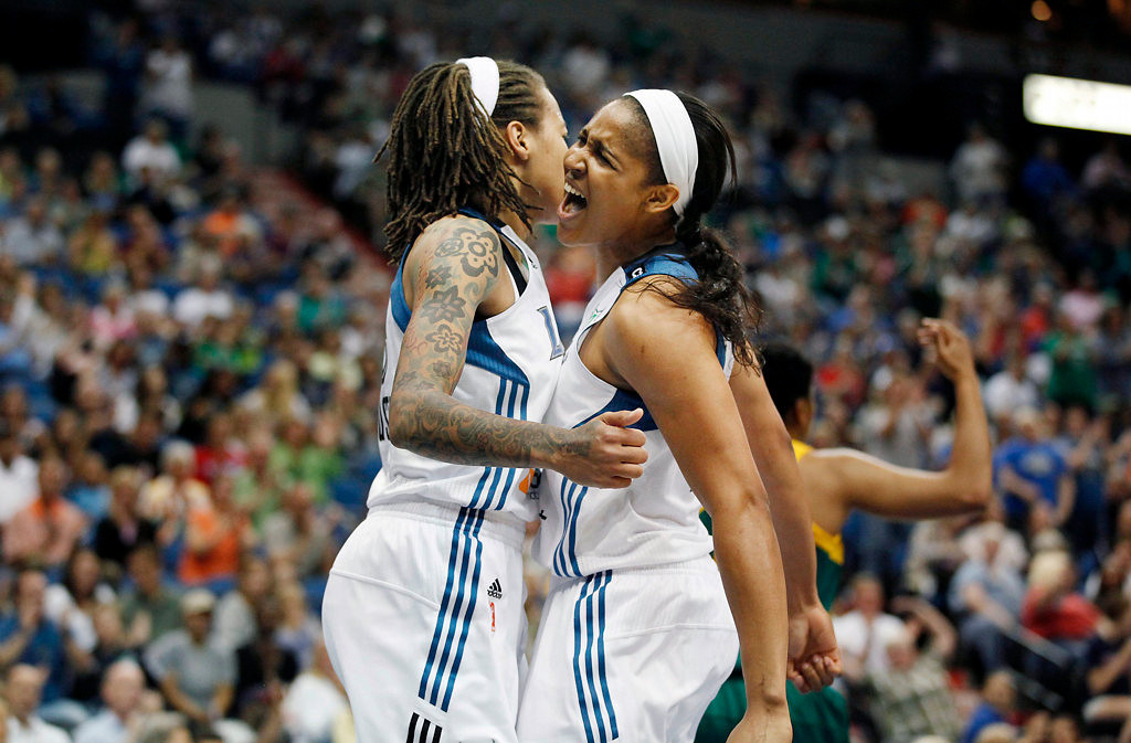 . Minnesota Lynx forward Maya Moore, right, celebrates with teammate guard Seimone Augustus  in the first half of a WNBA basketball game against the Seattle Storm, Sunday, Aug. 4, 2013, in Minneapolis. (AP Photo/Stacy Bengs)