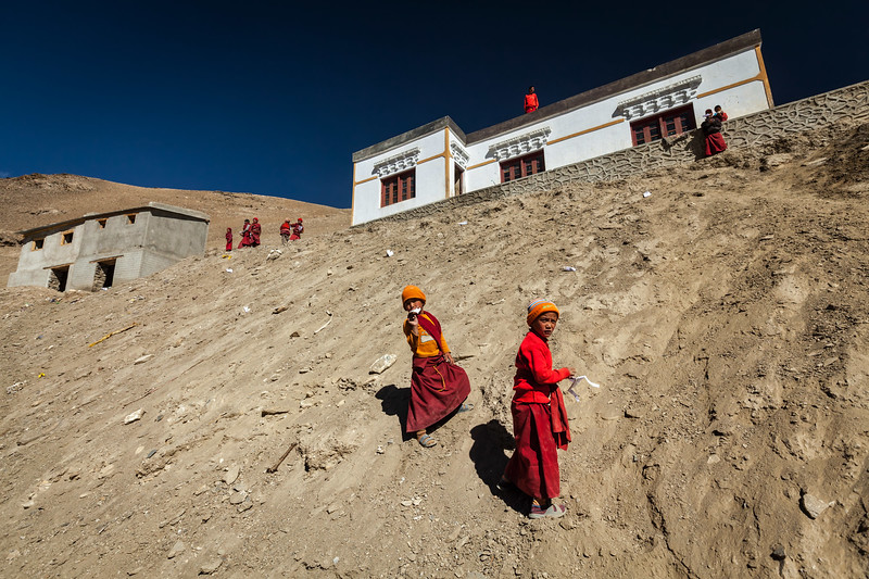 Children throwing paper planes. Korzok village, Tso Moriri (altitude 4600 m). Ladakh, India