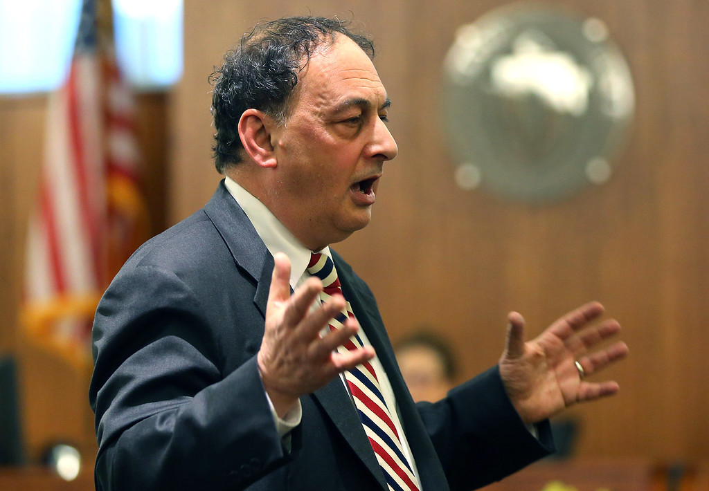 . Defense attorney James Sultan makes a point to the jury during closing remarks during the trial of former New England Patriots football player Aaron Hernandez in Fall River, Mass., Tuesday, April 7, 2015.  Hernandez is accused of killing Odin Lloyd in June 2013.  (AP Photo/The Boston Globe, John Tlumacki, Pool)