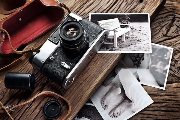 Old rangefinder camera and black-and-white photos.