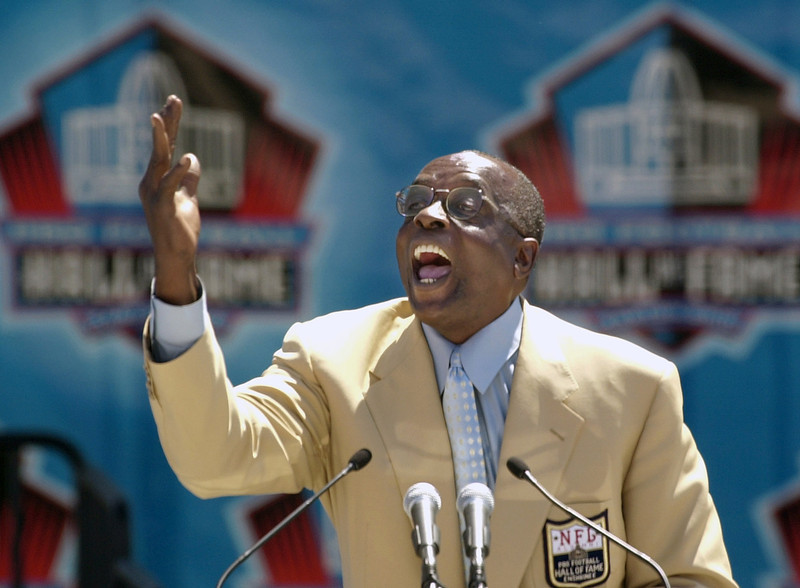 . In this Aug. 3, 2002 file photo, Hall of Fame defensive end Deacon Jones presents the late coach George Allen for enshrinement into the Pro Football Hall of Fame in Canton, Ohio. (AP Photo/Mark Duncan, File)