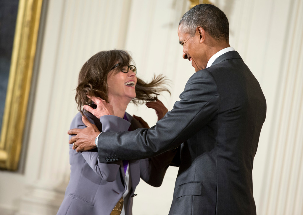 . President Barack Obama awards the 2014 National Medal of Arts to actress and filmmaker Sally Field of Los Angles during a ceremony in the East Room at the White House in Washington, Thursday, Sept. 10, 2015. (AP Photo/Andrew Harnik)