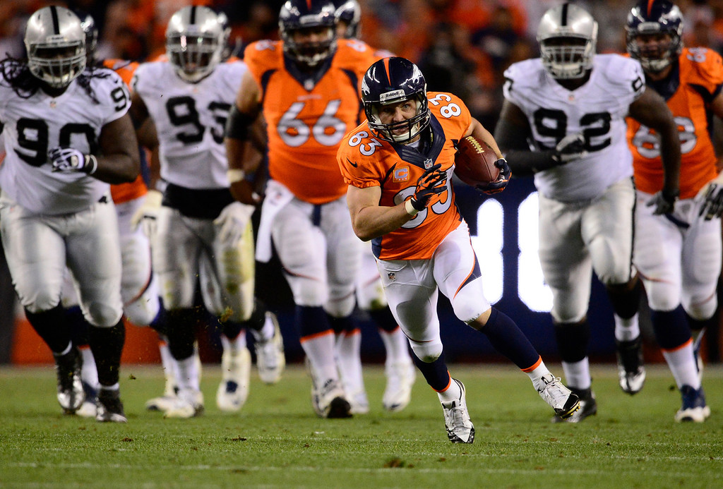 . DENVER, CO - SEPTEMBER 23: Denver Broncos wide receiver Wes Welker (83) breaks a tackle and runs up field in the second quarter. The Denver Broncos took on the Oakland Raiders at Sports Authority Field at Mile High in Denver on September 23, 2013. (Photo by AAron Ontiveroz/The Denver Post)