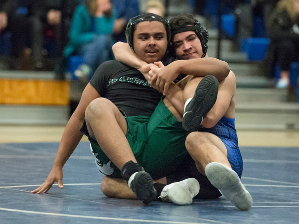 01/02/19 Wesley Bunnell | StaffrrPlainville wrestling was narrowly defeated at home by Maloney on Thursday night. Plainville's Esteban Torres vs Moises Hernandez in the 182lb match.