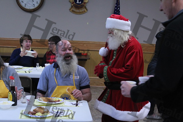 Lester Prairie Lions Club and visitors see Santa