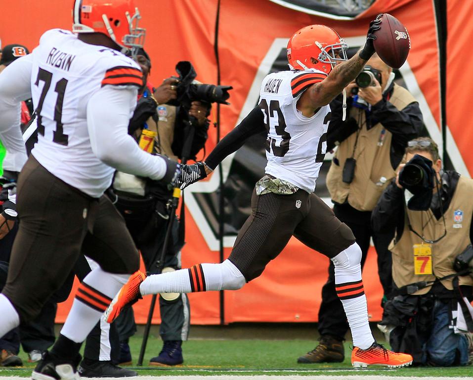 . Cleveland Browns cornerback Joe Haden (23) returns an interception for a touchdown in the first half of an NFL football game against the Cincinnati Bengals, Sunday, Nov. 17, 2013, in Cincinnati. (AP Photo/Tom Uhlman)