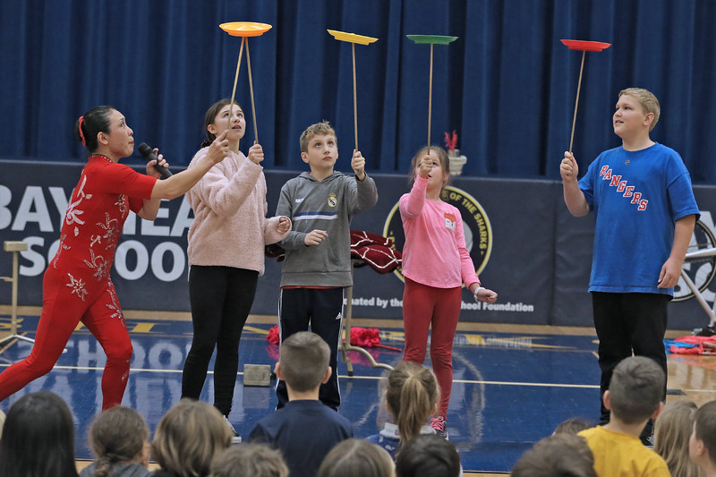 Acrobat Li Liu (left)  show students how to plate spin during her show for students at the Bay Head Elementary School in Bay Head on Friday Feb. 1, 2019.  (MARK R. SULLIVAN/THE OCEAN STAR)