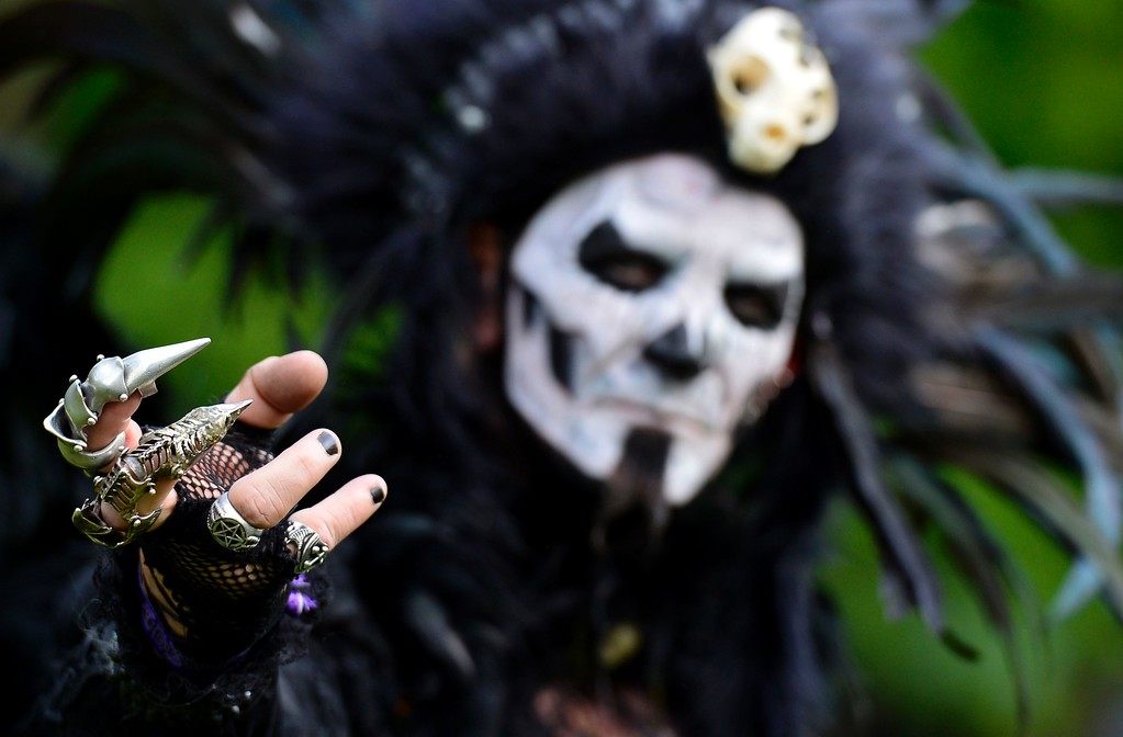 """. A dressed up man poses at a so-called \""""Victorian Picnic\"""" during the Wave-Gotik-Treffen (WGT) festival in Leipzig, eastern Germany, on May 13, 2016.   / AFP PHOTO / TOBIAS SCHWARZ/AFP/Getty Images"""