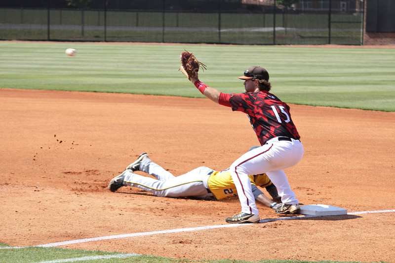 Gardner-Webb attempts to make an out on a first base pick off