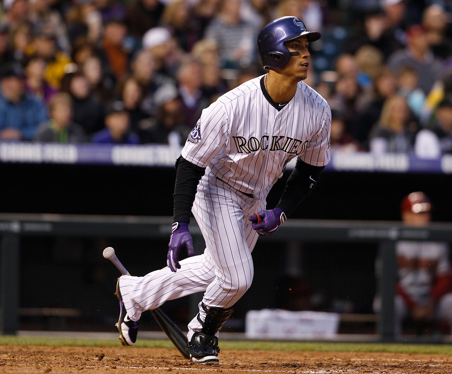 . Colorado Rockies\' Carlos Gonzalez follows the flight of his double against the Arizona Diamondbacks in the fifth inning of a baseball game in Denver, Saturday, April 20, 2013. (AP Photo/David Zalubowski)