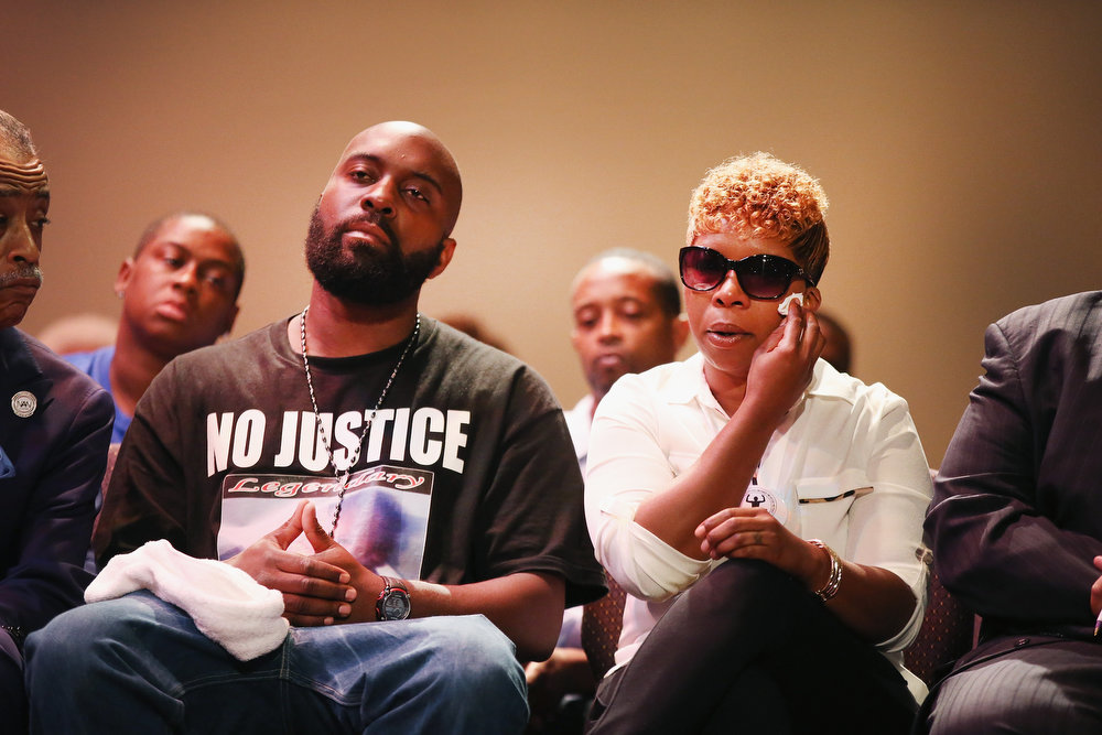 . Michael Brown Sr. and Lesley McSpadden, the parents of slain teenager Michael Brown, attend a rally at Greater Grace Church on August 17, 2014 in Ferguson, Missouri. Their son was shot and killed by a Ferguson police officer on August 9. Despite the Brown family\'s continued call for peaceful demonstrations, violent protests have erupted nearly every night in Ferguson since his death.  (Photo by Scott Olson/Getty Images)