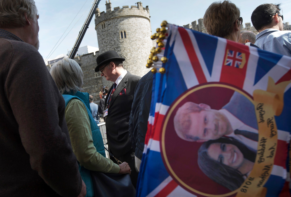 . A man wearing a bowler hat passes in front of Windsor castle, England, Friday, May 18, 2018. Preparations continue in Windsor ahead of the royal wedding of Britain\'s Prince Harry and Meghan Markle Saturday May 19. (AP Photo/Peter Dejong)