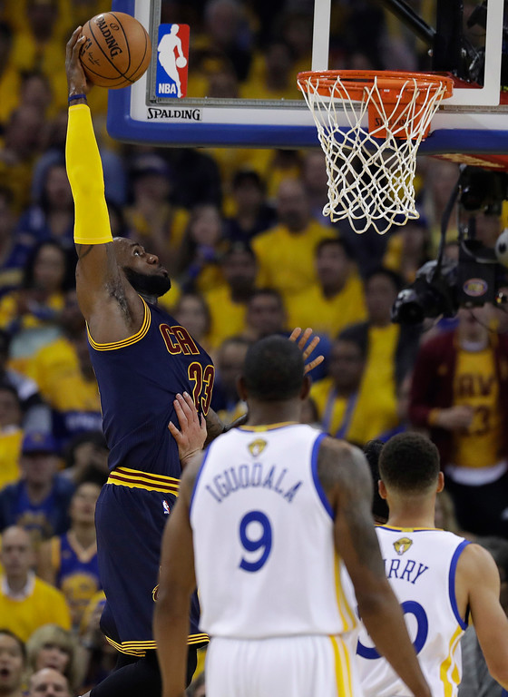 . Cleveland Cavaliers forward LeBron James (23) dunks against the Golden State Warriors during the first half of Game 1 of basketball\'s NBA Finals in Oakland, Calif., Thursday, June 1, 2017. (AP Photo/Marcio Jose Sanchez)