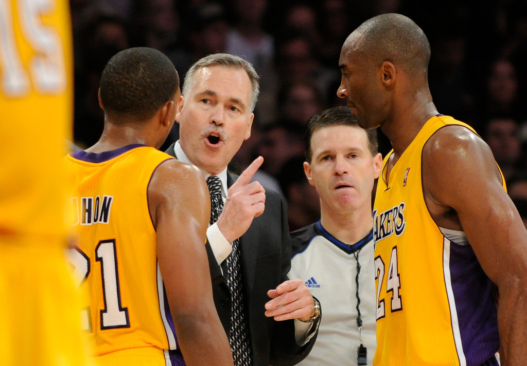 . Mike D\'Antoni gives some instruction in the final seconds to Chris Duhon and Kobe Bryant. The Lakers defeated the Brooklyn Nets 95-90 in a game played at Staples Center in Los Angeles, CA. The game was new coach Mike D\'Antoni\'s first victory as a Laker. 11/20/12 (photos by John McCoy/Staff Photographer)