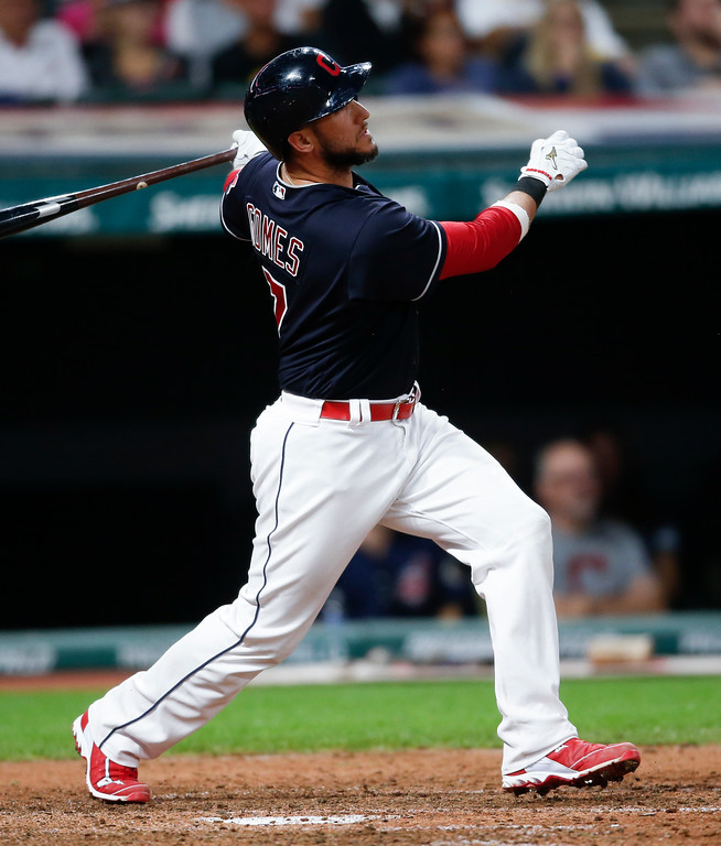 . Cleveland Indians\' Yan Gomes watches a solo home run off Minnesota Twins relief pitcher Michael Tonkin during the sixth inning in a baseball game, Wednesday, Sept. 27, 2017, in Cleveland. (AP Photo/Ron Schwane)