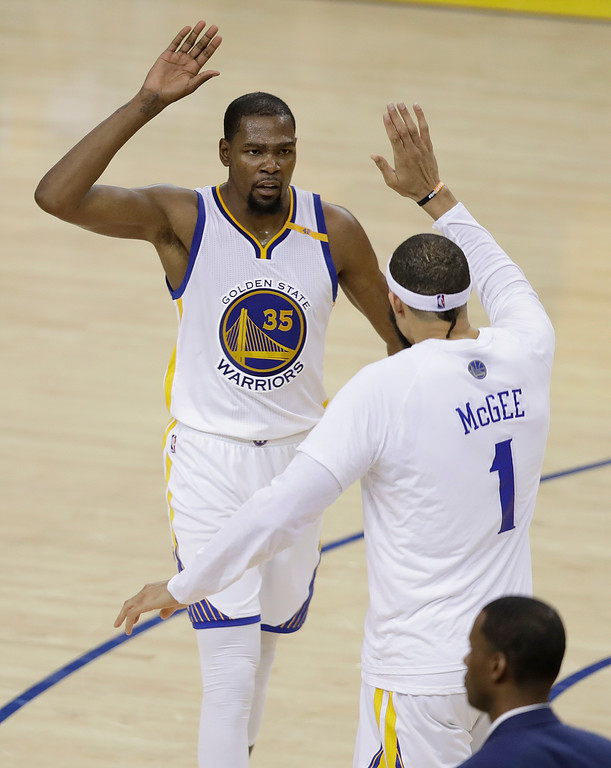 . Golden State Warriors forward Kevin Durant (35) and center JaVale McGee (1) celebrate during the second half of Game 2 of basketball\'s NBA Finals against the Cleveland Cavaliers in Oakland, Calif., Sunday, June 4, 2017. (AP Photo/Marcio Jose Sanchez)