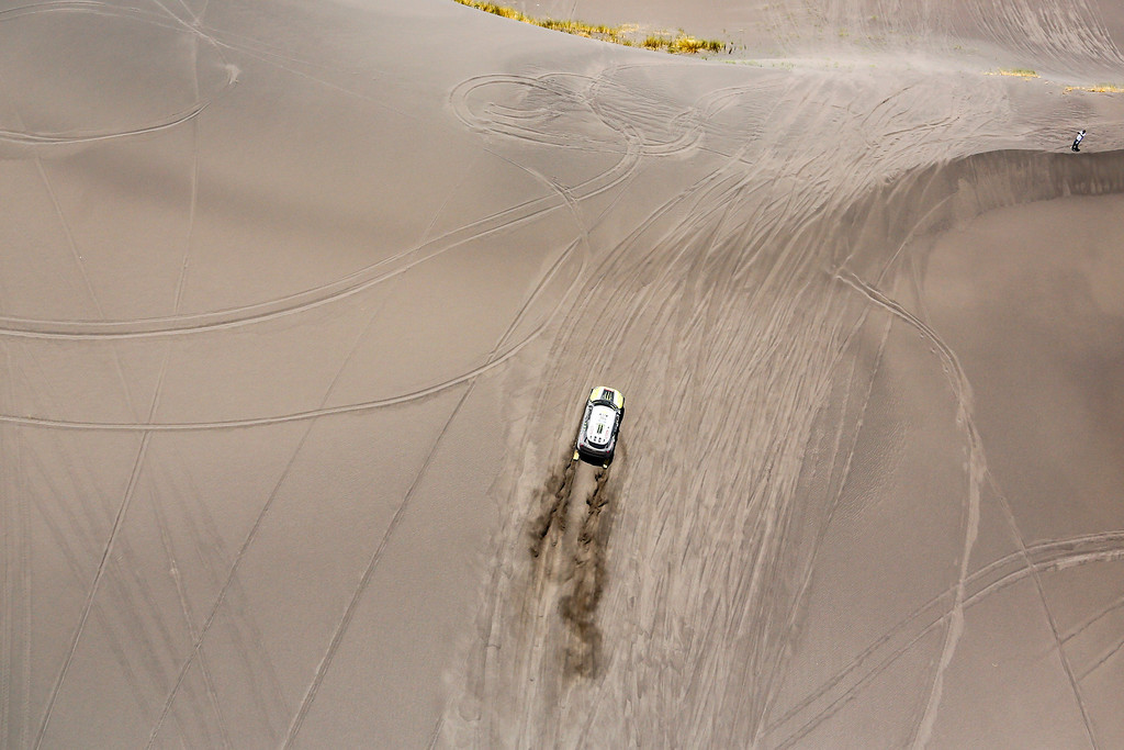 """. Mini driver Joan \""""Nani\"""" Roma of Spain and co-pilot Michel Perin of France race up a dune during the second stage of the Dakar Rally between the cities of San Luis and San Rafael in San Rafael, Argentina,  Monday, Jan. 6, 2014. This is the sixth consecutive year the race has been run in South America, and the first time Bolivia has been on the route. (AP Photo/Victor R. Caivano)"""