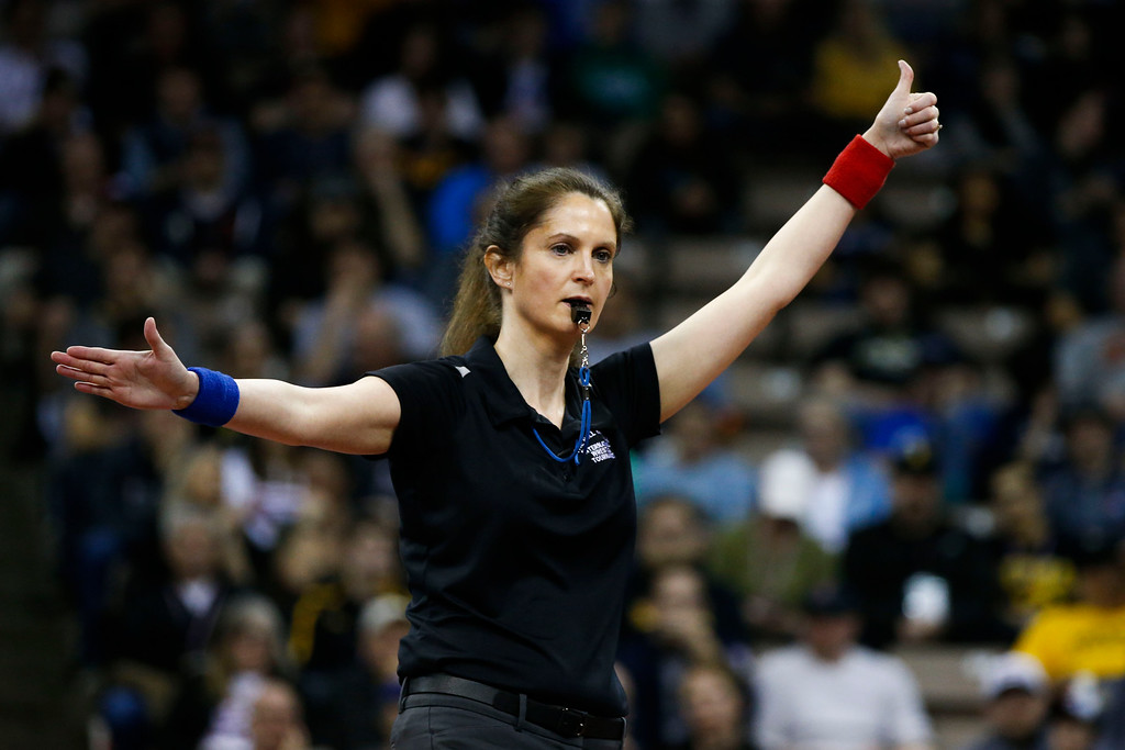. The referee awards Adeline Gray points for a takedown in the championship round at the 2016 U.S. Olympic Trials at Carver-Hawkeye Arena in Iowa City, Iowa on Sunday, April 10, 2016. The three-time world champion hopes to become the first American woman to win an Olympic gold medal in Rio this summer. Gray won the first of her two bouts by decision 11-0. (Rebecca F. Miller for The Denver Post)