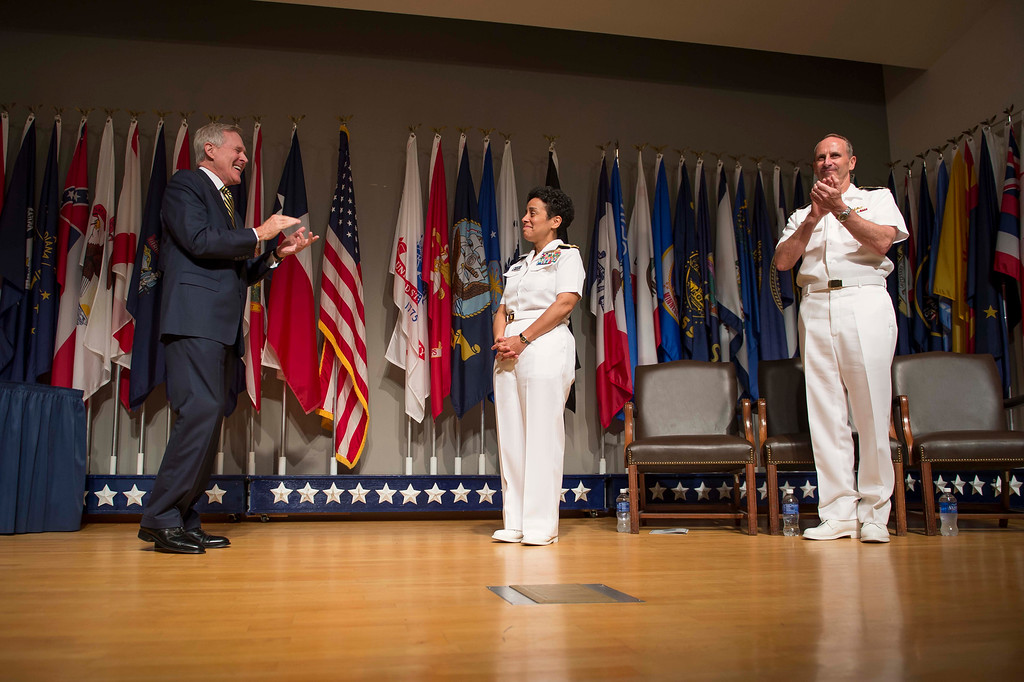 . In this handout photo provided by the U.S. Navy, Secretary of the Navy Ray Mabus (L) and Chief of Naval Operations (CNO) Adm. Jonathan Greenert (R) applaud Adm. Michelle Howard (C) on her promotion to the rank of admiral at the Women in Military Service for America Memorial on July 1, 2014 in Washington, D.C. Howard is the first woman to be promoted to the rank of admiral in the history of the Navy and will assume the duties and responsibilities as the 38th Vice Chief of Naval Operations from Adm. Mark Ferguson. (Photo by Peter D. Lawlor/U.S. Navy via Getty Images)