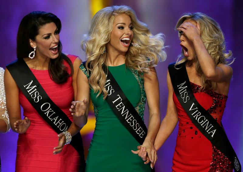 . Miss Virginia Courtney Paige Garrett, right, gasps after she is announced as a finalist during the Miss America 2015 pageant, Sunday, Sept. 14, 2014, in Atlantic City, N.J. Garrett took first runner up honors while Miss New York Kira Kazantsev won the crown. Looking on are Miss Oklahoma Alex Eppler, left, and Miss Tennessee Hayley Lewis. (AP Photo/Julio Cortez)