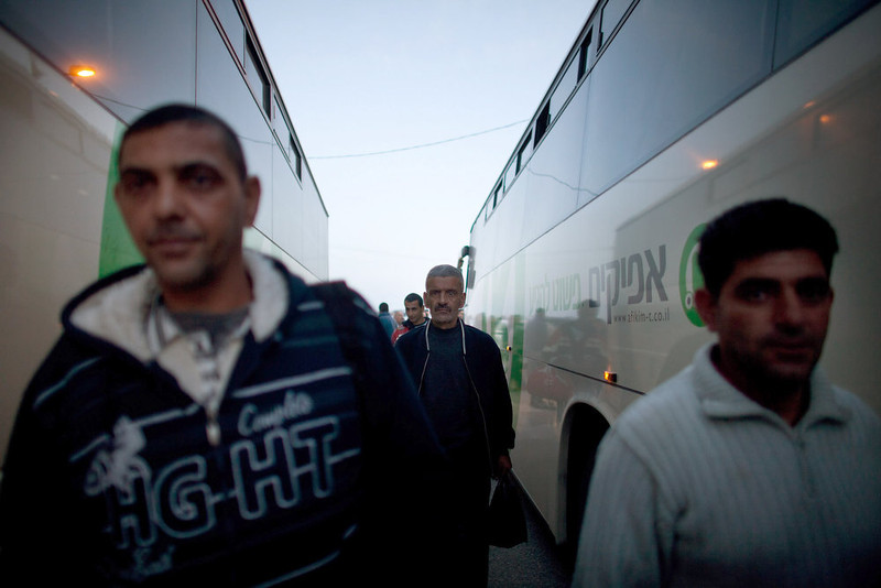 . Palestinians board a bus as a new line is made available by Israel to take Palestinian laborers from the Israeli army crossing of Eyal, near the West Bank town of Qalqilya, into Israeli cities on March 4, 2013. The new line service to ferry Palestinian workers from the West Bank to Israel, encouraging them to use it instead of traveling with Israeli settlers on a similar route.   (Photo by Uriel Sinai/Getty Images)