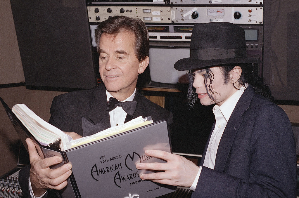 . Michael Jackson and American Music Awards executive producer Dick Clark go over the show?s script during rehearsals for this year?s show, Saturday, Jan. 24, 1993 at the Shrine Auditorium in Los Angeles. Jackson is nominated for five awards and will open the show with a live performance. The awards, chosen by the American record-buying public, will be presented on the show which airs on Monday night on ABC. (AP Photo)