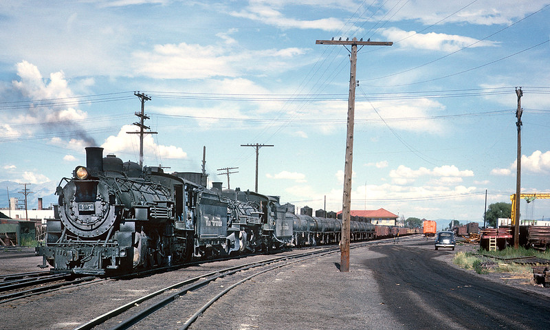 July 22, 1963.  Alamosa. The 497 and 488 are about ready to leave Alamosa for Chama.