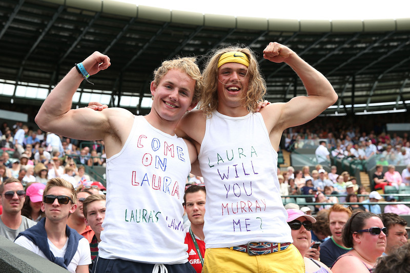 . Fans of Laura Robson of Great Britain pose with messages printed on their vests before her Ladies\' Singles fourth round match against Kaia Kanepi of Estonia on day seven of the Wimbledon Lawn Tennis Championships at the All England Lawn Tennis and Croquet Club on July 1, 2013 in London, England.  (Photo by Clive Brunskill/Getty Images)