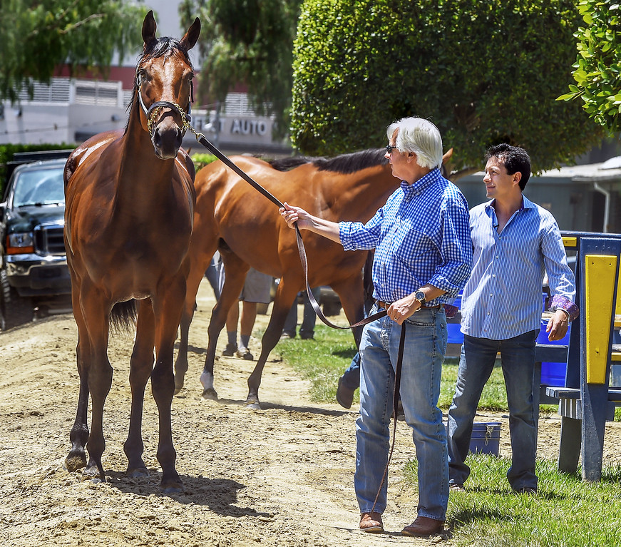 . Bob Baffert, trainer and jockey Victor Espinoza with American Pharoah at Santa Anita Park. Racehorse American Pharoah returned to Southern California, Thursday, June 18, 2015, for the first time since breaking a 37-year Triple Crown drought by winning the Kentucky Derby, Preakness and Belmont Stakes. American Pharaoh was aboard an equestrian airline from Louisville, Ky., to Ontario International Airport, where he will be loaded into a van and driven to Santa Anita Park.(Photo by Walt Mancini/Pasadena Star-News)