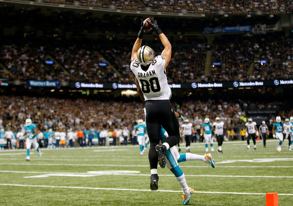 . Tight end Jimmy Graham #80 of the New Orleans Saints catches a 27-yard touchdown in the second quarter against the Miami Dolphins at the Mercedes-Benz Superdome on September 30, 2013 in New Orleans, Louisiana.  (Photo by Chris Graythen/Getty Images)
