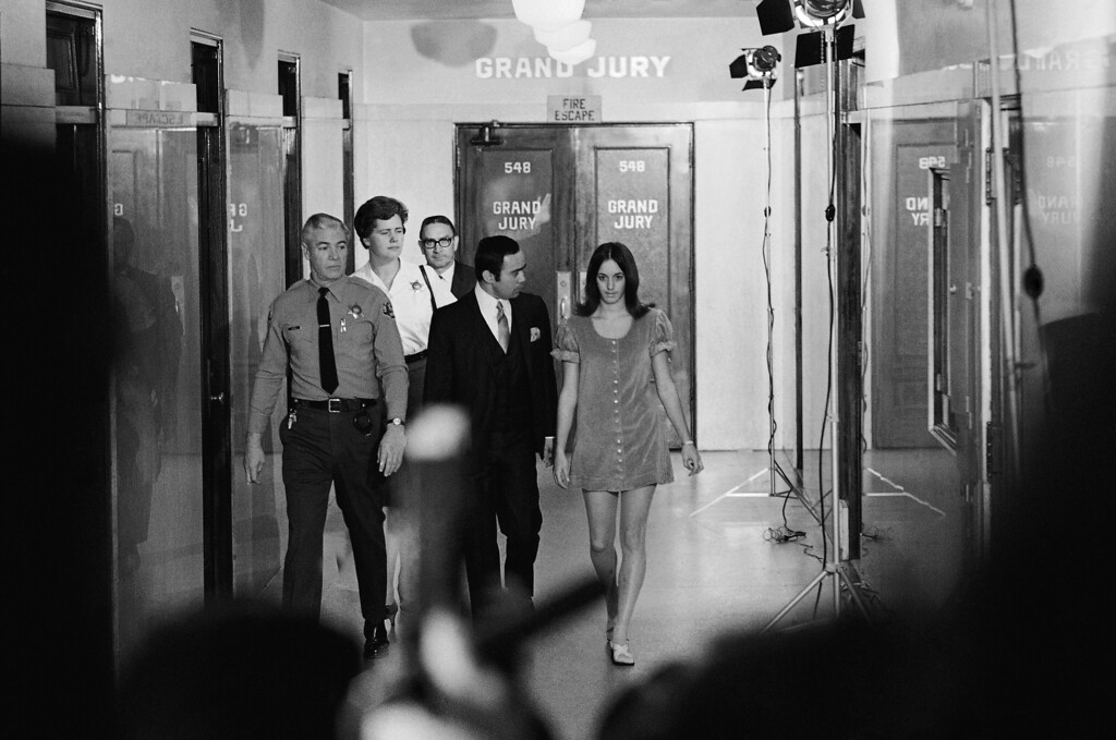". Susan Denise Atkins, 21, leaves the grand jury room in the Los Angeles Hall of Justice, Dec. 5, 1969 after testifying about the murders of actress Sharon Tate and four others. Her attorney, Richard Caballero, who is pictured with her, said before her appearance that she would waive rights against self-incrimination and would ""tell the grand jury exactly what happened.\"" (AP Photo/Dick Strobel)"