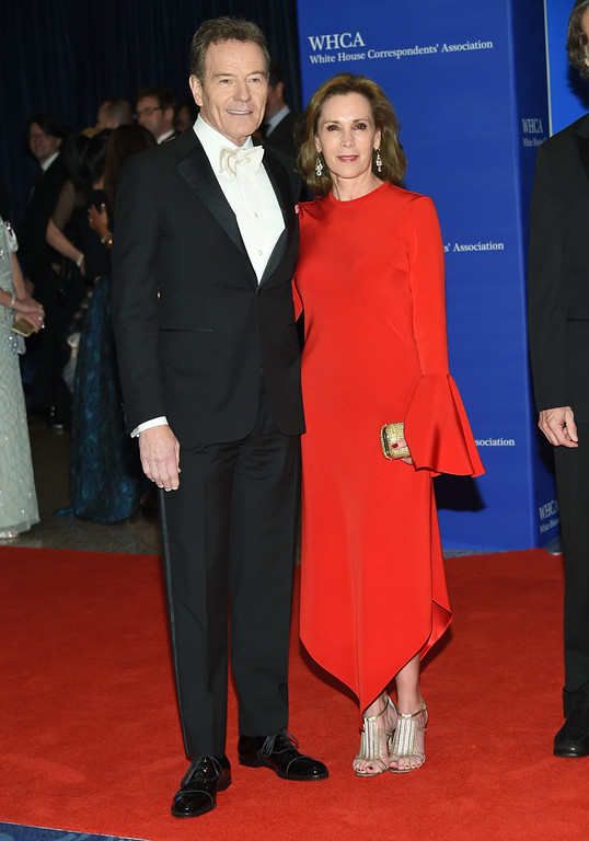 . Bryan Cranston, left, and Robin Dearden arrive at the White House Correspondents\' Association Dinner at the Washington Hilton Hotel on Saturday, April 30, 2016, in Washington. (Photo by Evan Agostini/Invision/AP)