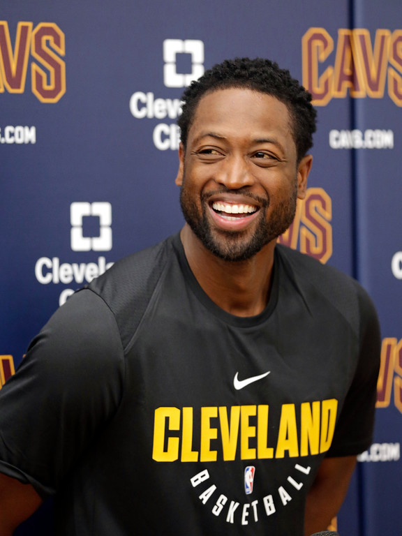 . Cleveland Cavaliers\' Dwyane Wade smiles as he answers questions during a news conference at the NBA basketball team\'s training facility, Friday, Sept. 29, 2017, in Independence, Ohio. Wade once convinced LeBron James that Miami was the place to be. Seven years later, James lured Wade to Ohio for the chance to win another NBA title, together. (AP Photo/Tony Dejak)