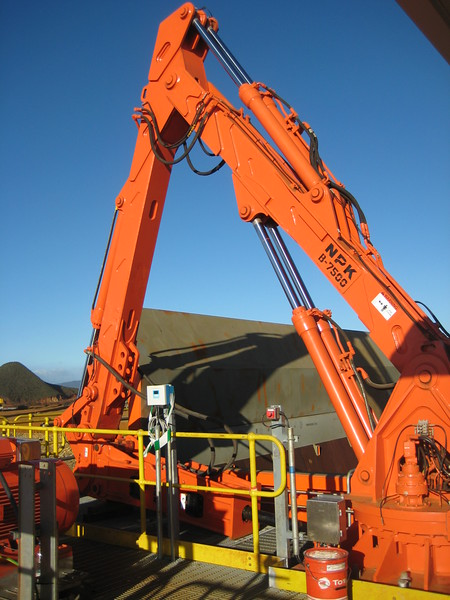 NPK B7500 pedestal boom system with GH9 hydraulic hammer-breaking bridged rock at grizzly crusher in quarry (3).jpg
