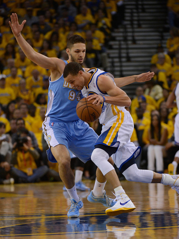 . OAKLAND, CA. - APRIL 26: Evan Fournier (94) of the Denver Nuggets plays tight defense on Stephen Curry (30) of the Golden State Warriors during the first quarter in game 3 of the first round of the NBA Playoffs April 26, 2013 at Oracle Arena.  (Photo By John Leyba/The Denver Post)
