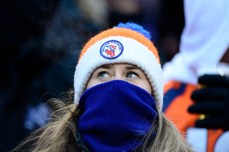 . Broncos fans try to keep warm in the stands. The Denver Broncos vs Baltimore Ravens AFC Divisional playoff game at Sports Authority Field Saturday January 12, 2013. (Photo by AAron  Ontiveroz,/The Denver Post)