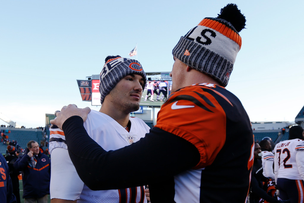 . Chicago Bears quarterback Mitchell Trubisky, left, meets with Cincinnati Bengals quarterback Andy Dalton, right, after an NFL football game, Sunday, Dec. 10, 2017, in Cincinnati. The Bears won 33-7. (AP Photo/Frank Victores)