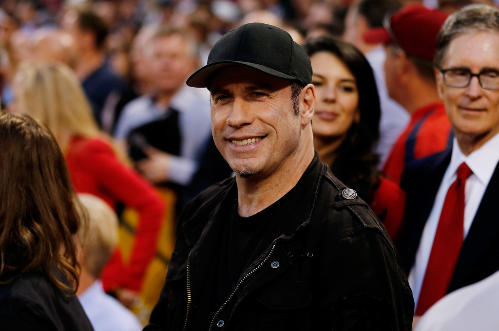 . Actor John Travolta attends Game One of the American League Division Series between the Boston Red Sox and the Tampa Bay Rays at Fenway Park on October 4, 2013 in Boston, Massachusetts.  (Photo by Jim Rogash/Getty Images)