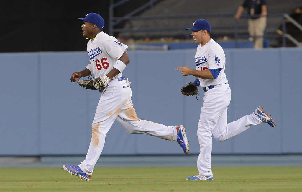 . Yasiel Puig and Andre Ethier leave the field after the final out is recorded against the Padres June 3, 2013 in Los Angeles, CA.  The Dodgers won the game 2-1.(Andy Holzman/Staff Photographer)